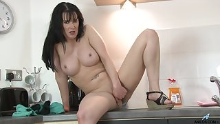 Fake boobs brunette Tanya Cox drops her clothes in the pantry