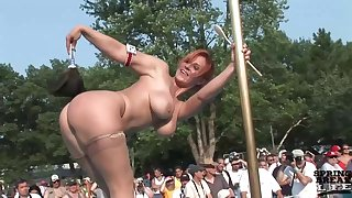 Naked ladies are posing plus teasing on the stage, in front of many excited people